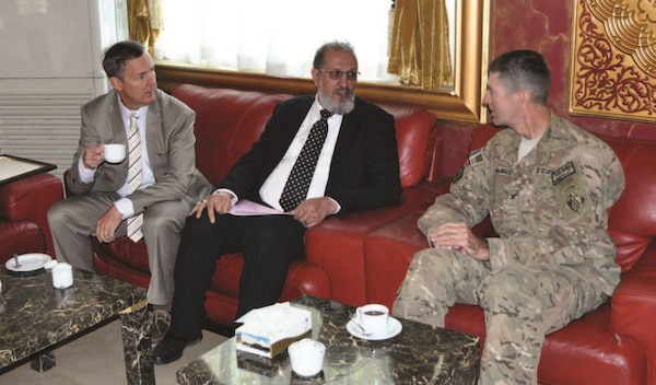 (Left to right) Gordon Simmons, Chief of Engineering & Construction, USACE Transatlantic Afghanistan District; Ahad Wahad, Deputy Mayor of Kabul City;  and Col. Pete Helmlinger, USA, Commander, USACE Transatlantic Afghanistan District, discuss engineering challenges in the rapid expansion of Kabul City.