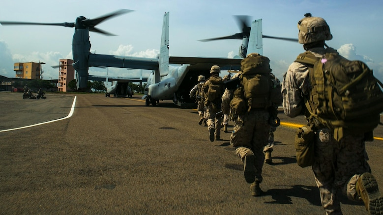 A squad of U.S. Marines with Special-Purpose Marine Air-Ground Task Force Crisis Response-Africa rush onto an MV-22B Osprey in Accra, Ghana, March 27, 2015. The Marines conducted combat loading and offloading drills designed to hone their ability to rapidly embark on the aircraft and secure a landing zone.