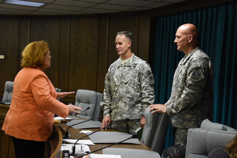 U.S. Sen. Heidi Heitkamp talks with Mississippi Valley Division Commander Maj. Gen. Michael Wehr, center, and St. Paul District Commander Col. Dan Koprowski following a stakeholder meeting at Minot City Hall July 6, 2015. This is Maj. Gen. Wehr's first trip to see areas damaged in Minot and Ward County, N.D., during the 2011 flood.