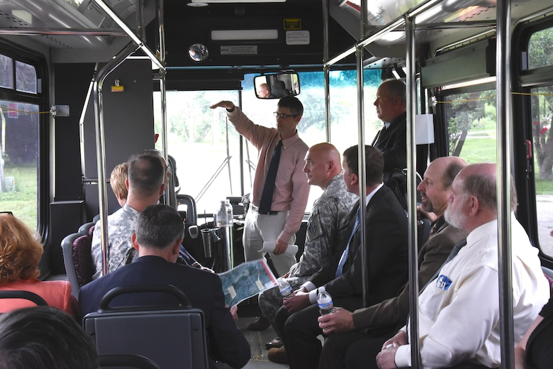 Nathan Wallerstedt, St. Paul District project manager for Minot, N.D., area projects, points out items of interest to Mississippi Valley Division Commander Maj. Gen. Michael Wehr and stakeholders during a bus tour following the stakeholder meeting on July 6. This is Maj. Gen. Wehr's first trip to see areas damaged in Minot and Ward County, N.D., during the 2011 flood.
