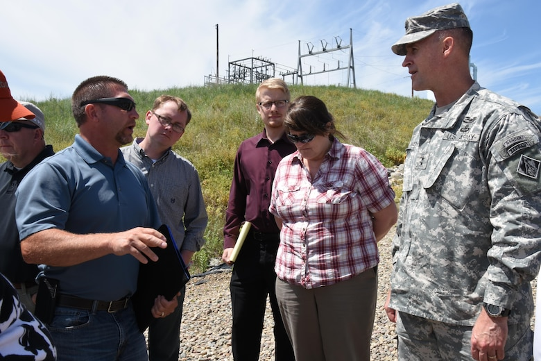 During Maj. Gen. Michael Wehr, Mississippi Valley Division commander, July 6-8, 2015, visit to North Dakota, Jon Kelsch, North Dakota State Water Commission, explains the operation of the Devils Lake West End Outlet structure, which can pump water out of Devils Lake at the  rate of 250 cubic feet per second. The Devils Lake basin is a 3,810 square-mile sub-basin of the Red River of the North with no natural outlet until lake levels reach an elevation 1,458, at which it flows through Tolna Coulee into the Sheyenne River.