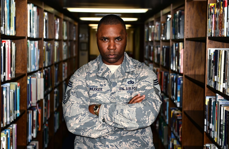 U.S. Air Force Chief Master Sgt. Marvin Parker, 36th Mission Support Group superintendent, holds a doctorate in business administration, summa cum laude. Since completing his transportation management Community College of the Air Force degree in 2003, Parker hasn't stop pursuing higher education and hopes to motivate other Airmen to follow his example. (U.S. Air Force photo by Senior Airman Alexander W. Riedel/Released)