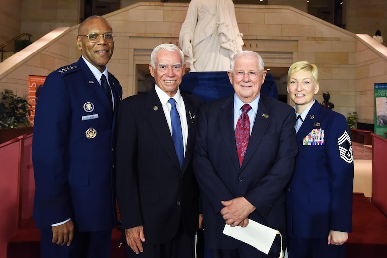 Air Force Vice Chief of Staff Gen. Larry O. Spencer, retired Air Force Col. Michael Brazelton, retired Air Force Col. William Driggers Jr., and the executive assistant to the chief master sergeant of the Air Force, Chief Master Sgt. Nicole Johnson, pose for photo in the Emancipation Hall of the U.S. Capitol Building in Washington, July 8, 2015, after the Congressional Commemoration of the 50th Anniversary of the Vietnam War. (U.S. Air Force photo/Staff Sgt. Carlin Leslie)