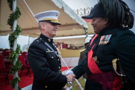 Brig. Gen. Christopher Mahoney, deputy commander, U.S. Marine Corps Forces, Pacific, shakes hands with Brig. Gen. Hon Fielakepa, chief commander, His Majesty's Armed Forces, after the King's coronation celebration in Nuku'alofa, Tonga, July 6, 2015. The U.S. cultivates a strong partnership with Tonga through participation in significant cultural and ceremonial events.