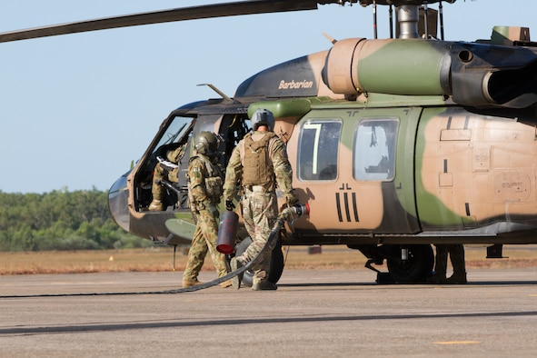 U.S. Air Force Airmen from the 18th Logistics Readiness Squadron from Kadena Air Base, Japan, partnered with the Australian Army during a refueling exercise at the Royal Australian Air Force Base Darwin, July 8, 2015, in Darwin, Australia, during Talisman Sabre 2015. Talisman Sabre is a biennial exercise that provides an invaluable opportunity for nearly 30,000 U.S. and Australian defense forces to conduct operations in a combined, joint and interagency environment that will increase both countries' ability to plan and execute a full range of operations from combat missions to humanitarian assistance efforts. (U.S. Army photo by Sgt. Steven Peterson/Released)