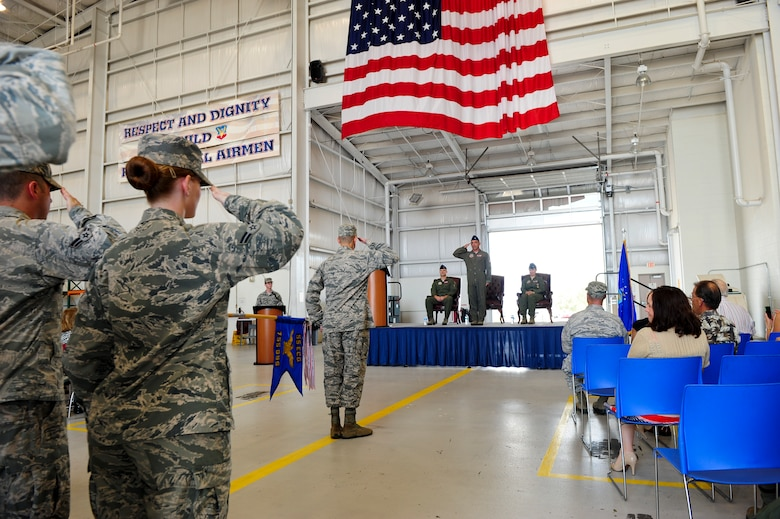 U.S. Air Force Lt. Col. Joshua Koslov, 755th Operations Support Squadron commander, renders his first salute to Airmen from the 755th OSS after assuming command of the squadron during a change of command ceremony at Davis-Monthan Air Force Base, Ariz., July 9, 2015. Before assuming command of the 755th OSS, Koslov served as the director of operations of the 43rd Electronic Combat Squadron. (U.S. Air Force photo by Airman 1st Class Chris Drzazgowski/Released)