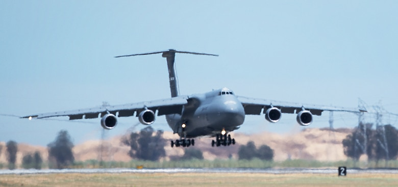 Delivery of a newly refurbished C-5M Super Galaxy arrives at Travis Air Force Base, California, July 8, 2015. The newly-modernized aircraft is the seventh C-5M to return to Travis following retrograde and refurbishment. The C-5M Super Galaxy incorporates more than 70 aircraft improvements, including new GE CF6-80C2 engines that support a 22 percent increase in thrust, 55 percent greater climb rate, tenfold increase in engine reliability and Stage 4 noise and emission compliance. (U.S. Air Force photo by Ken Wright)