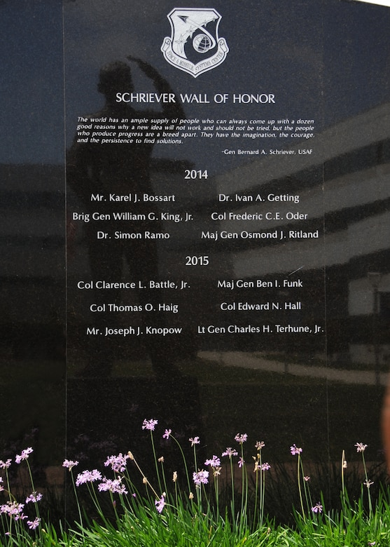 Six early Air Force and civilian space pioneers were honored during a ceremony May 14, 2015 to unveil their names, newly inscribed on a wall of polished black granite at the General Bernard A. Schriever Memorial, located on the grounds of the Space and Missile Systems Center at Los Angeles Air Force base in El Segundo, Calif. (U.S. Air Force photo/Van Ha)