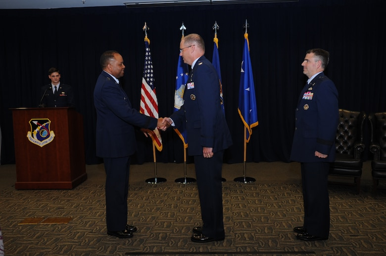 Lt. Gen. Samuel Greaves, presiding official and commander of Air Force Space Command's Space and Missile Systems Center at Los Angeles Air Force Base, Calif., congratulates Col. Steven Whitney on accepting the reins of responsibility as incoming director of the Global Positioning Systems Directorate during a change of leadership ceremony July 8 in the Gordon Conference Center. Whitney succeeds Brig. Gen. William Cooley, the outgoing director, who leaves for his new assignment at the Redstone Arsenal in Huntsville, Alabama with the Missile Defense Agency after leading the GP Directorate at SMC for the past two years. (U.S. Air Force photo/ Van Ha)