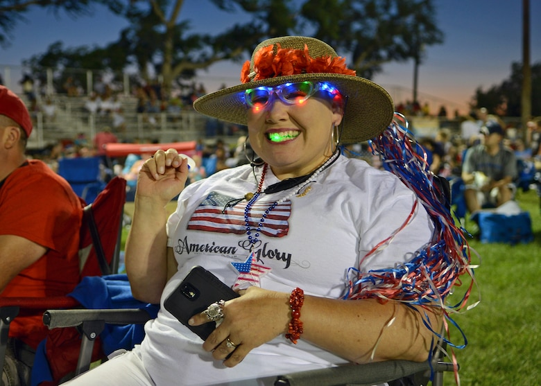 An attendee during the 2015 Freedom Fest exhibits her colorful patriotism prior to the national anthem and fireworks demonstration held July 4 at Wings and Roberts Fields. (U.S. Air Force photo by Jet Fabara)