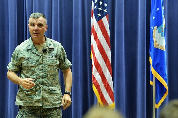 U.S. Air Force Col. Robert Swanson, strategic plans and interagency integration office chief at the Pentagon, speaks to Team Offutt members during a suicide prevention brief inside the 557th Weather Wing headquarters building on Offutt AFB, Neb., July 7. Swanson gives personal testimony of how he overcame his struggles after his suicide attempts and provides listeners with ways that they can help themselves in moments of crisis. (Photo by Charles Haymond)