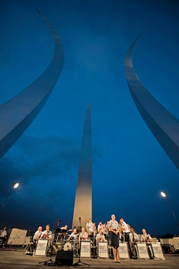 The Airmen of Note performs between the spires of the Air Force Memorial in Arlington, Virginia, in celebration of Independence Day. (U.S. Air Force Photo by A1C Philip Bryant/released)