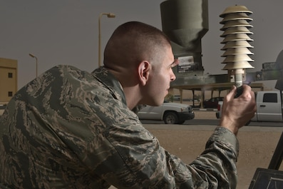Capt. Kevin Eaton, 379th Expeditionary Operations Support Squadron, looks for wear and tear on a Tactical Meteorological Observing Sensor during a daily function check July 8, 2015 Al Udeid Air Base, Qatar.