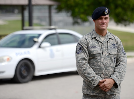 Air Force Reservist Master Sgt. Christopher Enfinger, 47th Security Forces Squadron alternate operations superintendent, poses at the 47th SFS on Laughlin Air Force Base, Texas, July 8, 2015. When not serving in his reservist capacity, Enfinger is one of only 25 officers, detectives, and sergeants assigned to the San Antonio Police Department Gang Unit who is responsible for tracking, documenting and monitoring more than 10,000 gang members and over 30 different gangs throughout San Antonio. (U.S. Air Force photo by Tech Sgt. Steven R. Doty)