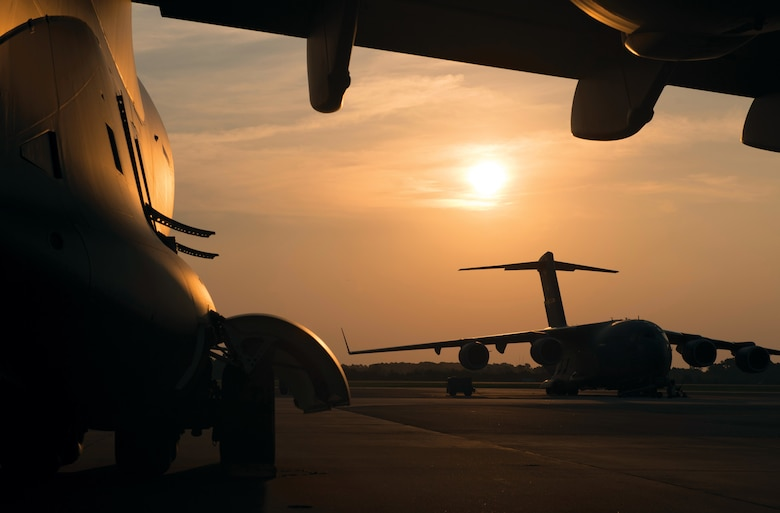 C-17 Globemaster IIIs assigned to the 437th Airlift Wing await training missions at Joint Base Charleston, S.C., June 30, 2015. Training flights are vital to the operational success of Air Force personnel because they help develop the necessary skills for combat and humanitarian missions. (U.S. Air Force photo/Tech. Sgt. Barry Loo)