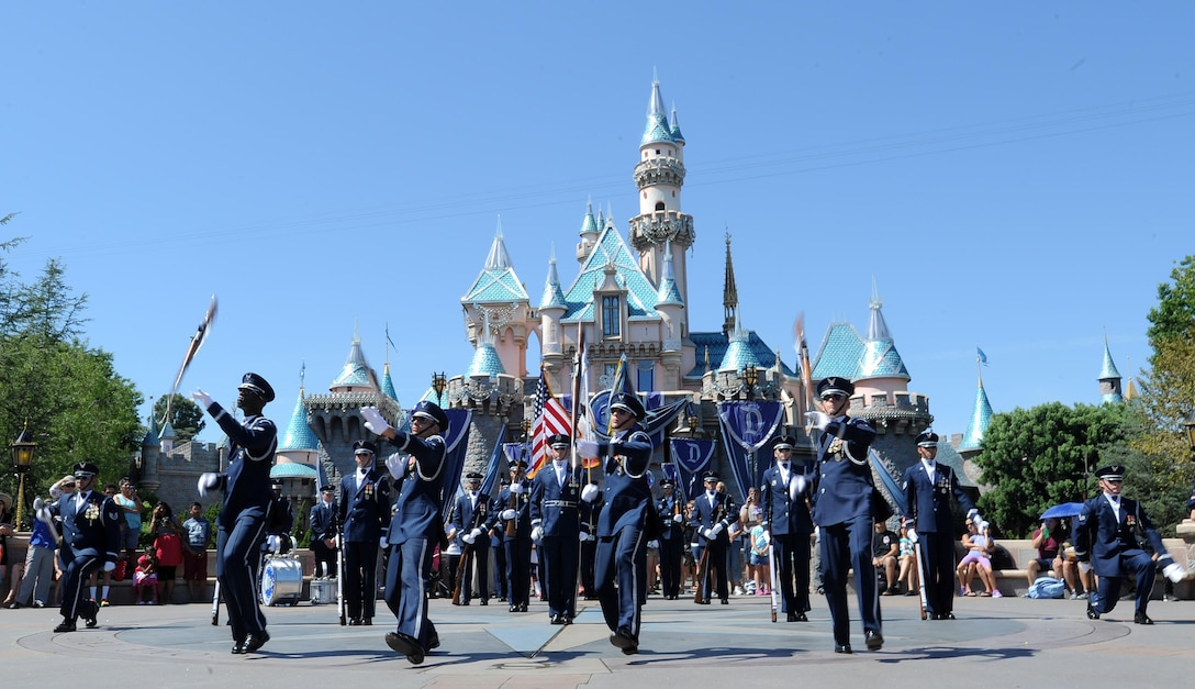 The U.S. Air Force Honor Guard performs at Disneyland in Anaheim, Calif., July 2, 2015. During the Fourth of July weekend each year, Disneyland invites military units to the park for special performances -- a tradition started by Walt Disney on opening day. (U.S. Air Force photo/Staff Sgt. Nichelle Anderson)