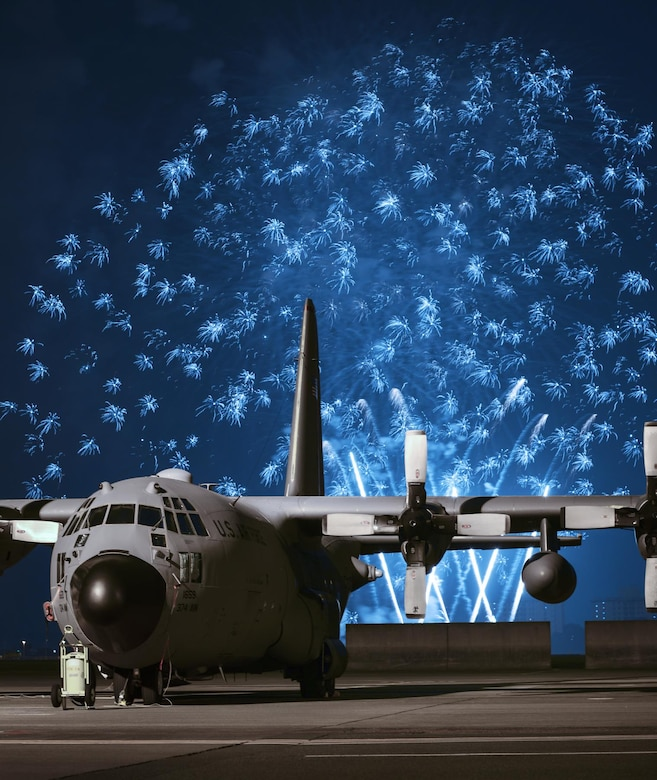 Fireworks explode behind a C-130 Hercules during Celebrate America, July 2, 2015, at Yokota Air Base, Japan. Celebrate America is an annual event that provides military members and their families the opportunity to enjoy games, food and bands before culminating in a fireworks display to celebrate Independence Day. (U.S. Air Force photo/Airman 1st Class Delano Scott)