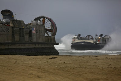 U.S. Navy Landing Craft Air Cushioned (LCAC) vehicle from Assault Craft Unit 5 lands on Red Beach as part of a loading exercise along side Combat Logistics Battalion 11, Headquarters Regiment, 1st Marine Logistics Group aboard Camp Pendleton, Calif., June 23, 2015. This loading exercise reinforces the Marine Corps role as an amphibious force in readiness by maintaining capabilities through realistic training. (U.S. Marine Corps photo by Lance Cpl. Lauren Falk/Released)