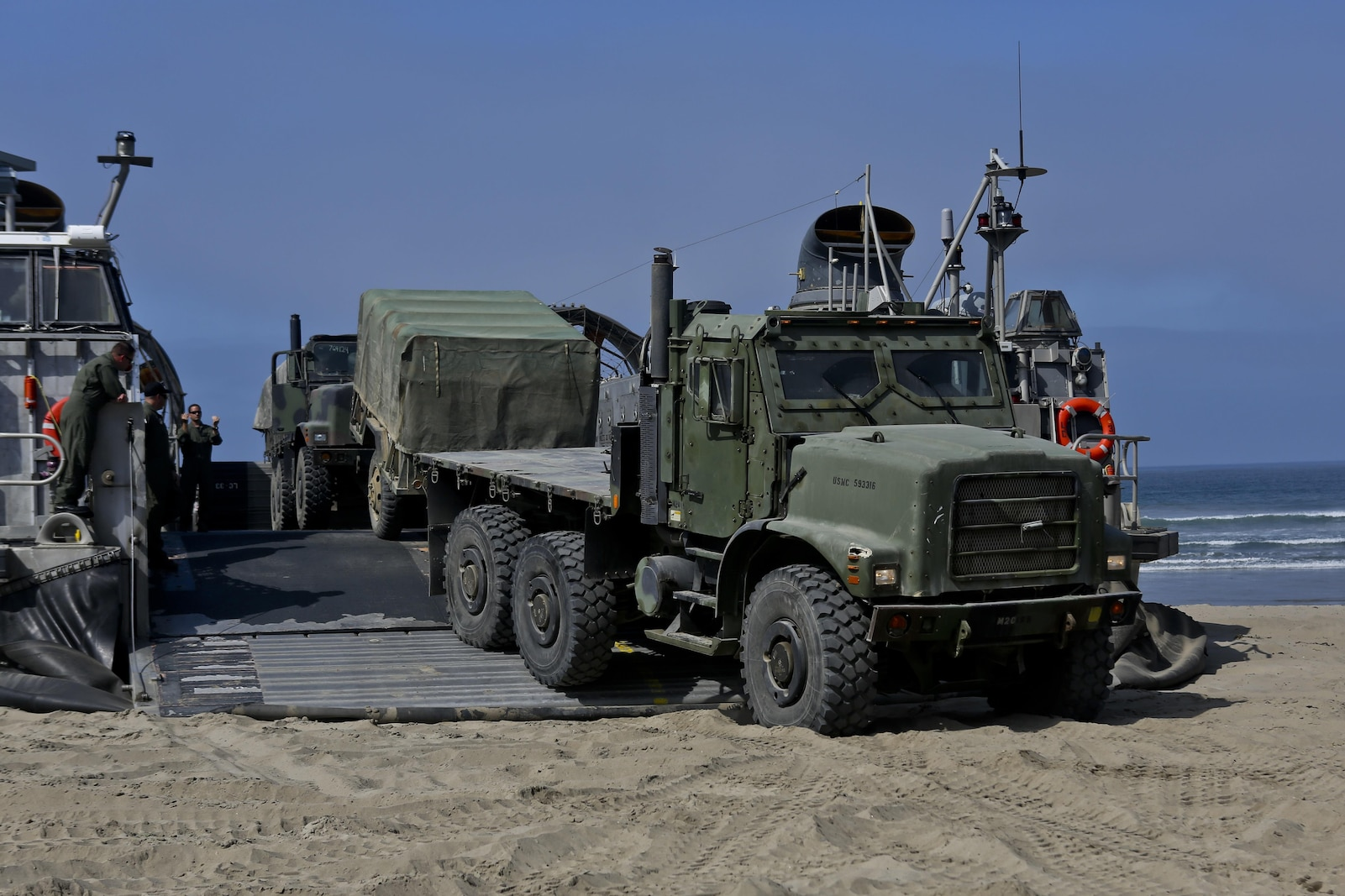 A Landing Craft Air Cushioned vehicle from Assault Craft Unit 5 unloads a Medium Tactical Vehicle Replacement onto Red Beach as part of a loading exercise along side Combat Logistics Battalion 11, Headquarters Regiment, 1st Marine Logistics Group, aboard Camp Pendleton, Calif., June 23, 2015. This loading exercise reinforces the Marine Corps' role as an amphibious force in readiness by maintaining capabilities through realistic training.(U.S. Marine Corps photo by Lance Cpl. Lauren Falk/Released)