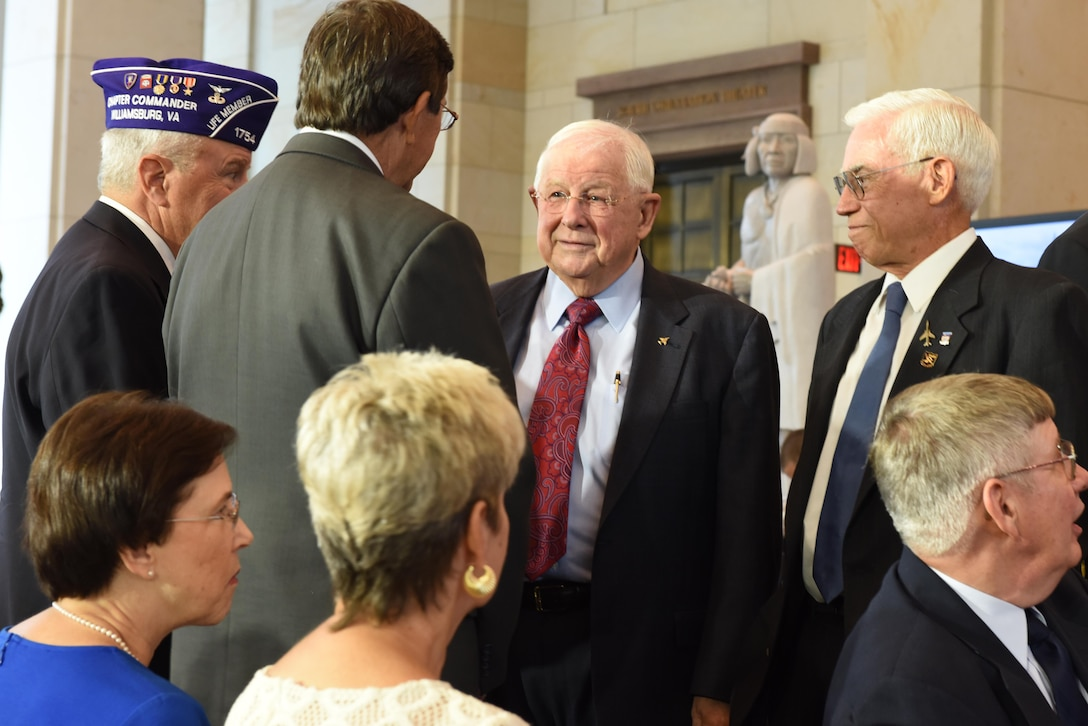 Retired Cols. William Driggers Jr. and Michael Brazelton (right) speak with other Vietnam War veterans during the Congressional Commemoration for the 50th Anniversary of the Vietnam War in the Emancipation Hall of the U.S. Capitol in Washington, July 8, 2015. (U.S. Air Force photo/Staff Sgt. Carlin Leslie)