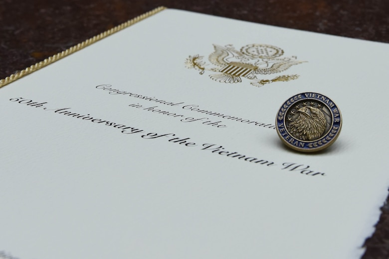 """A lapel pin for Vietnam War veterans was designed for the Congressional Commemoration of the 50th Anniversary of the Vietnam War.  On the back of the pin are the words """"A grateful nation thanks and honors you."""" The pin is available to those who served on active duty in the Armed Forces from Nov. 1, 1955-May 15, 1975, regardless of location. (U.S. Air Force photo/Staff Sgt. Carlin Leslie)"""