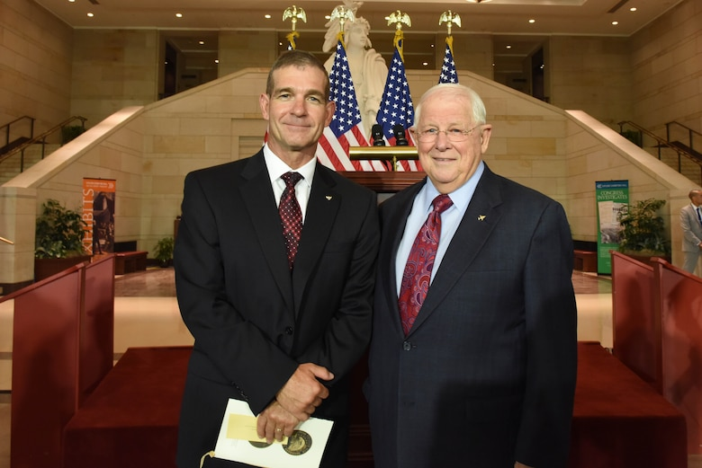 Retired Maj. Gen. Mark A. Barrett, the acting president of the Air Force Association, stands with retired Col. William Driggers Jr. at the Congressional Commemoration for the 50th Anniversary of the Vietnam War July 8, 2015, in the Emancipation Hall of the U.S. Capitol in Washington. Driggers was one of ten Vietnam veterans recognized at the congressional event. (U.S. Air Force photo/Staff Sgt. Carlin Leslie)