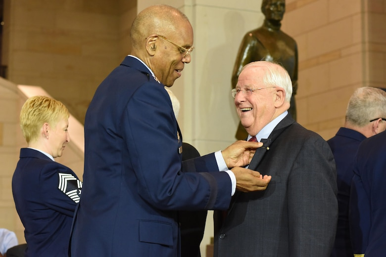 Air Force Vice Chief of Staff Gen. Larry O. Spencer pins a commemorative Vietnam veteran lapel pin on retired Col. William Driggers Jr. during the Congressional Commemoration of the 50th Anniversary of the Vietnam War July 8, 2015, in the Emancipation Hall of the U.S. Capitol in Washington. (U.S. Air Force photo/Staff Sgt. Carlin Leslie)