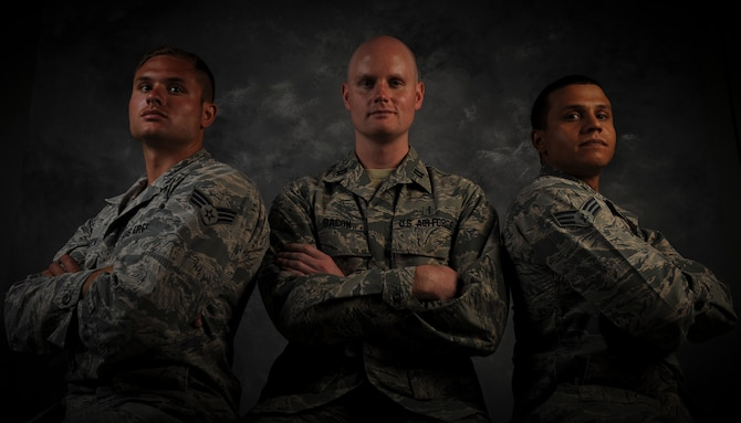 Senior Airman Gregory Tamuzza, 823rd Maintenance Squadron rescue specialist, left, Capt. Lance Bacon, 99th Medical Operations Squadron emergency medicine physician, and Senior Airman Jerome Coley, 99th Communications Squadron knowledge operator, pose for a photo at Nellis Air Force Base, Nev., June 9, 2015. The three Airmen's swift actions helped save the lives of two unconscious passengers when their vehicle rolled over on Interstate 15, May 31 in Las Vegas. (U.S. Air Force photo by Airman 1st Class Mikaley Towle)