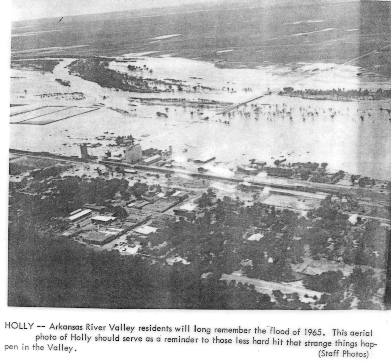 Holly - Arkansas River Valley residents will long remember the flood of 1965. This aerial photo of Holly should serve as a reminder to those less hard hit that strange things happen in the Valley.  Special thanks to John Martin Reservoir staff for scanning this historic photo.