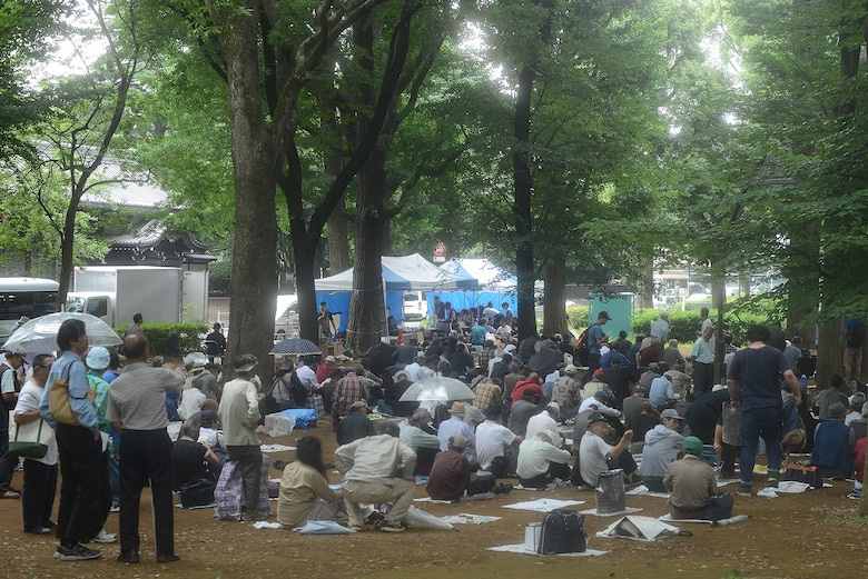 Homeless men and women gather to receive meals prepared by volunteers from Yokota Air Base, Japan, and members of a local church at Ueno Park, Tokyo Japan, June 26, 2015. More than 400 people are fed at each homeless outreach event. (U.S. Air Force photo by Airman 1st Class David C. Danford/Released)
