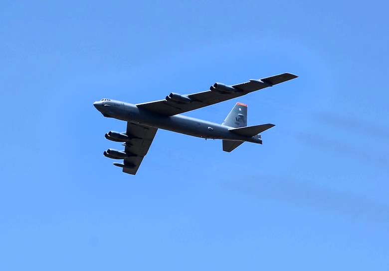 A U.S. Air Force B-52 Stratofortress can be seen flying over the Jose Maria Cordova International Airport during a flyover demonstration at the Colombian International Air Festival, July 9, 2015 in Rionegro, Colombia. The aircraft took off from its home station at Minot Air Force Base, N.D., to conduct a 16-hour, long-range training mission which included the flyover in Colombia. The B-52 Stratofortress is a long-range strategic aircraft capable of traveling 8,800 miles before refueling. (U.S. Air Force photo by MSgt. Kristina Newton/Released)