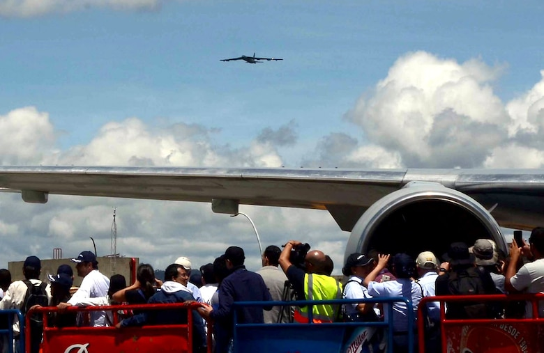 A crowd watches the arrival of a U.S. Air Force B-52 Stratofortress at the Jose Maria Cordova International Airport during a flyover demonstration at the Colombian International Air Festival, July 9, 2015 in Rionegro, Colombia. The aircraft took off from its home station at Minot Air Force Base, N.D., to conduct a 16-hour, long-range training mission which included the flyover in Colombia. The B-52 Stratofortress is a long-range strategic aircraft capable of traveling 8,800 miles before refueling. (U.S. Air Force photo by MSgt. Kristina Newton/Released)