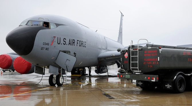 A KC-135 Stratotanker is refueled on the flightline at Selfridge Air National Guard Base, Mich., July 9, 2015. Fully loaded, a KC-135 can hold up to 203,000 pounds of fuel. On a typical, day the average load is around 40,000 pounds or 5,900 gallons of fuel. The amount of fuel a jet receives is dependent on what the mission requires. (U.S. Air National Guard Photo by Senior Airman Ryan Zeski/Released)