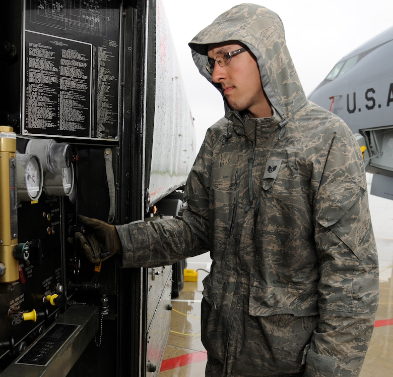 Staff Sgt. Daniel Vergun, 127th Logistics Readiness Squadron fuels technician, monitors the fuel truck gauges as he refuels a KC-135 Stratotanker on the flightline at Selfridge Air National Guard Base, Mich., July 9, 2015. The amount of fuel a jet receives is dependent on what the mission requires. On a typical day, the average load is around 40,000 pounds or 5,900 gallons of fuel. (U.S. Air National Guard Photo by Senior Airman Ryan Zeski/Released)