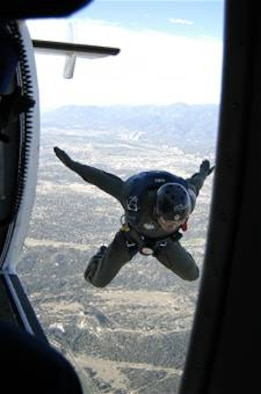 A U.S. Air Force Academy cadet departs a Twin-Otter jump plane from 4,500 feet above the academy during the during Airmanship 490 Basic Parachuting Course, an airmanship program where cadets earn their basic jump wings. (U.S. Air Force photo/Capt. Uriah Orland)