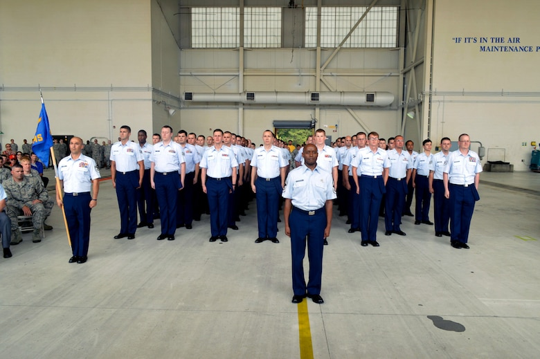 Chief Master Sgt. Kenneth Hubbard, 43rd Air Mobility Squadron superintendent, leads aircraft maintenance and aerial port Airmen who stand in formation together to form the new 43rd Air Mobility Squadron during the 43rd AMS activation ceremony July 1, 2015, at Pope Army Airfield, North Carolina. The 43rd Aircraft Maintenance Squadron and 3rd Aerial Port Squadron were inactivated and cased their guidons during the ceremony. (U.S. Air Force photo/Marvin Krause)