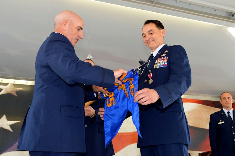 Lt. Col. Joseph Whittington Jr., 3rd Aerial Port Squadron commander, right, and Col. Kenneth Moss, 43rd Airlift Group commander, case the 3rd APS guidon during the 43rd Air Mobility Squadron activation ceremony July 1, 2015, at Pope Army Airfield, North Carolina. Aircraft maintenance and aerial port Airmen and functions transferred to the newly established 43rd AMS from the inactivated 3 APS and the 43rd Aircraft Maintenance Squadron. (U.S. Air Force photo/Marvin Krause)