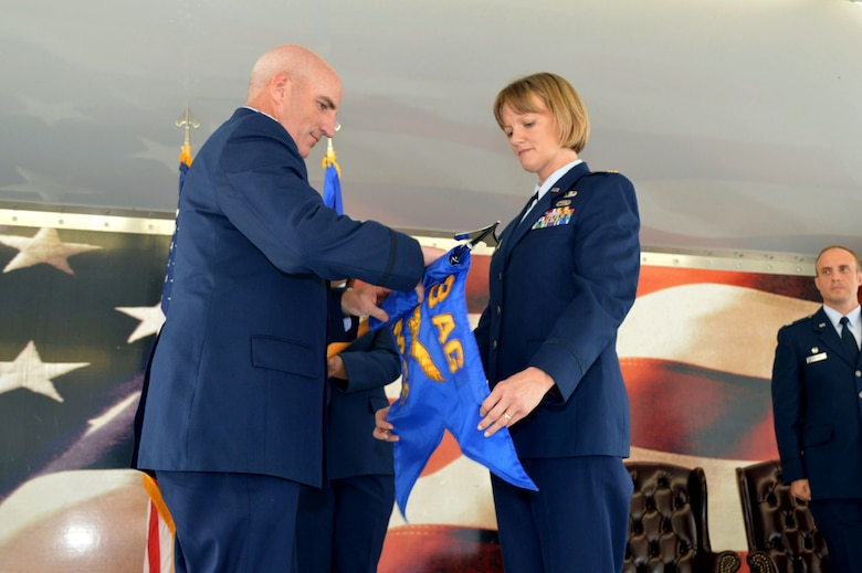 Maj. Michelle Taylor, 2nd Airlift Squadron commander, right, and Col. Kenneth Moss, 43rd Airlift Group commander, case the 43rd Aircraft Maintenance Squadron guidon during the 43rd Air Mobility Squadron activation ceremony July 1, 2015, at Pope Army Airfield, North Carolina. Aircraft maintenance and aerial port Airmen and functions transferred to the newly established 43rd AMS from the inactivated 3rd Aerial Port Squadron and the 43rd AMXS. (U.S. Air Force photo/Marvin Krause)