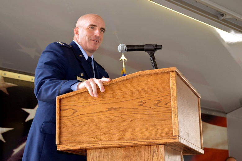 Col. Kenneth Moss, 43rd Airlift Group commander, addresses attendees during the 43rd Air Mobility Squadron activation ceremony July 1, 2015, at Pope Army Airfield, North Carolina. Aircraft maintenance and aerial port Airmen and functions transferred to the newly established 43rd AMS from the inactivated 3rd Aerial Port Squadron and the 43rd Aircraft Maintenance Squadron. (U.S. Air Force photo/Marvin Krause)
