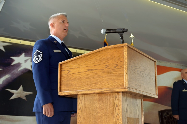 Master Sgt. John Norman II, Pope Airman and Family Readiness Center readiness, sings the National Anthem during the 43rd Air Mobility Squadron activation ceremony July 1, 2015, at Pope Army Airfield, North Carolina. Aircraft maintenance and aerial port Airmen and functions transferred to the newly established 43rd AMS from the inactivated 3rd Aerial Port Squadron and the 43rd Aircraft Maintenance Squadron. (U.S. Air Force photo/Marvin Krause)