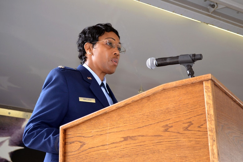 Lt. Col. Kimberly Wallace, 43rd Air Base Squadron commander, provides remarks to Airmen of the 43rd ABS and guests, after assuming command of the 43rd ABS July 1, 2015, during the 43rd ABS redesignation and change of command ceremony at Pope Army Airfield, North Carolina. Logistics and force support Airmen and functions transferred to the newly established squadron from the inactivated 43rd Logistics Readiness Squadron and the 43rd Force Support Squadron. (U.S. Air Force photo/Marvin Krause)