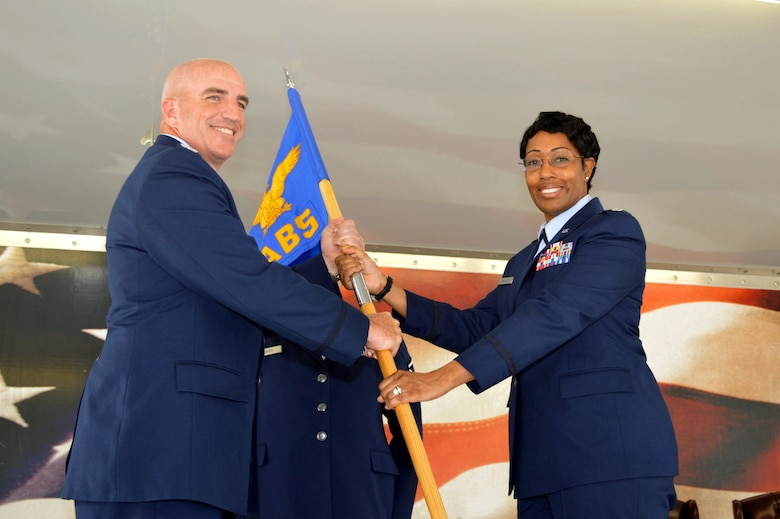 Col. Kenneth Moss, 43rd Airlift Group commander, left, passes the 43rd Air Base Squadron guidon to Lt. Col. Kimberly Wallace during the 43rd Air Base Squadron redesignation and change of command ceremony July 1, 2015, at Pope Army Airfield, North Carolina. Wallace assumed command of the newly established squadron composed of logistics and force support Airmen and functions transferred from the inactivated 43rd Logistics Readiness Squadron and the 43rd Force Support Squadron. (U.S. Air Force photo/Marvin Krause)