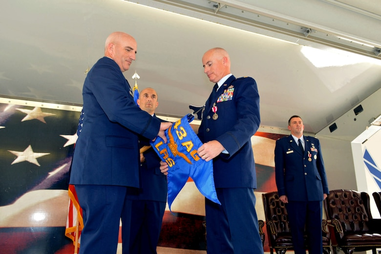 Maj. Peyton Smith, 43rd Logistics Readiness Squadron commander, right, and Col. Kenneth Moss, 43rd Airlift Group commander, case the 43rd LRS guidon during the 43rd Air Base Squadron redesignation and change of command ceremony July 1, 2015, at Pope Army Airfield, North Carolina. Logistics and force support Airmen and functions transferred to the newly established 43rd ABS from the inactivated 43rd LRS and the 43rd Force Support Squadron. (U.S. Air Force photo/Marvin Krause)
