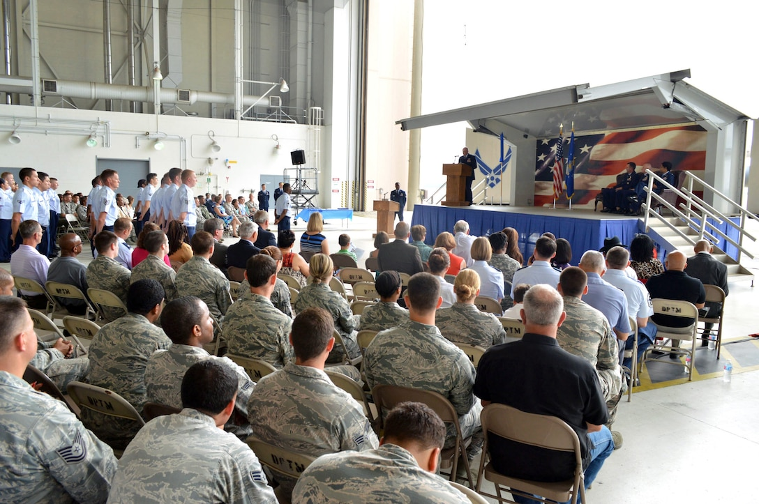 Col. Kenneth Moss, 43rd Airlift Group commander, addresses attendees during the 43rd Air Base Squadron redesignation and change of command ceremony July 1, 2015, at Pope Army Airfield, North Carolina. Logistics and force support Airmen and functions transferred to the newly established 43rd ABS from the inactivated 43rd Logistics Readiness Squadron and the 43rd Force Support Squadron. (U.S. Air Force photo/Marvin Krause)