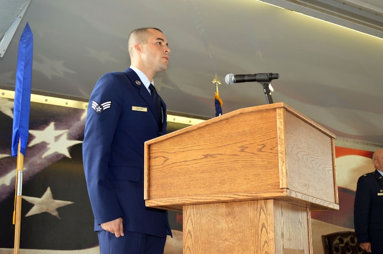 Senior Airman Anthony Carter, 43rd Air Base Squadron, sings the National Anthem during the 43rd ABS redesignation and change of command ceremony July 1, 2015, at Pope Army Airfield, North Carolina. Logistics and force support Airmen and functions transferred to the newly established 43rd ABS from the inactivated 43rd Logistics Readiness Squadron and the 43rd Force Support Squadron. (U.S. Air Force photo/Marvin Krause)