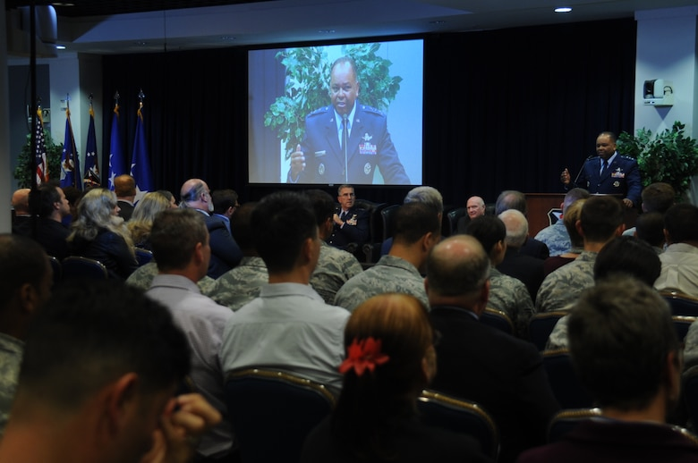 Lt. Gen. Samuel Greaves, Space and Missile Systems Center commander, addresses an audience of more than 300 attendees during a ceremony honoring six early Air Force and civilian space pioneers whose newly inscribed names were unveiled on a wall of polished black granite at the General Bernard A. Schriever Memorial, located on the grounds of Los Angeles Air Force Base in El Segundo, Calif. (U.S. Air Force photo/Van Ha)