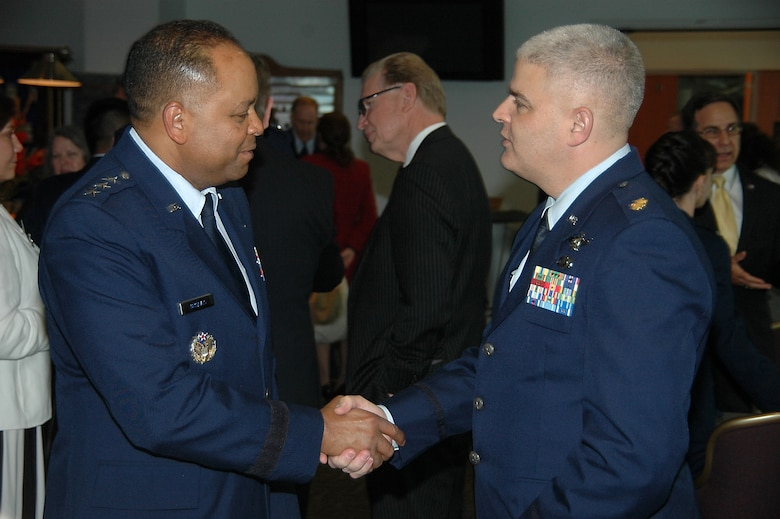 Lt. Gen. Samuel Greaves, Space and Missile Systems Center commander meets with Maj. Michael Schriever after a ceremony honoring six early Air Force and civilian space pioneers whose newly inscribed names were unveiled at the General Bernard A. Schriever Memorial, located at Los Angeles Air Force Base in El Segundo, Calif. Maj. Schriever is the grandson of General Schriever and chief of the National Reconnaissance Office headquarters Weapons and Tactics and deputy chief of NRO Special Technical Operations. (U.S. Air Force photo/James Spellman, Jr.)