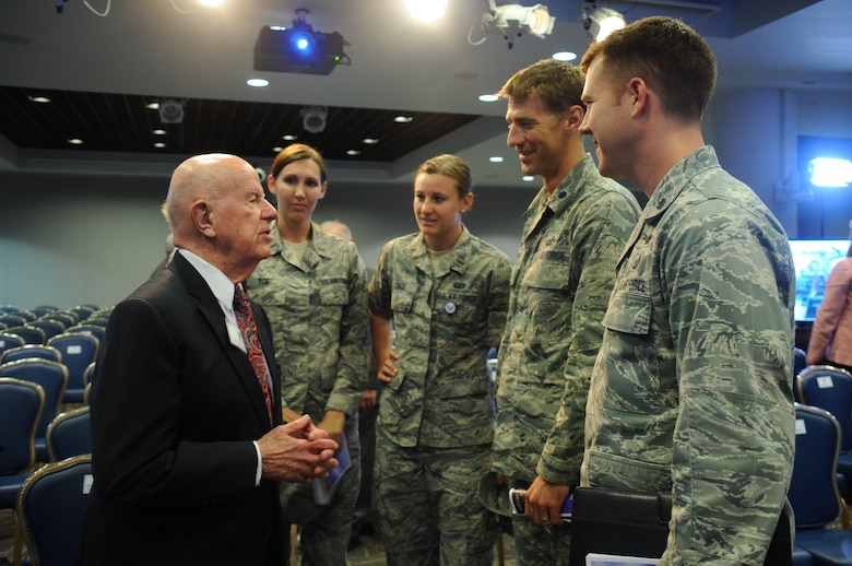A group of current Defense Meteorological Satellite Program officers meet with 94-year-old retired Air Force Col. Thomas Haig, the former DMSP director who created and managed the program when the National Reconnaissance Office established a meteorological satellite program in 1961. Haig is one of six early Air Force and civilian space pioneers who were honored during a ceremony unveiling their newly inscribed names on a wall of polished black granite at the General Bernard A. Schriever Memorial. The memorial and wall of honor are located on the grounds of the Space and Missile Systems Center at Los Angeles Air Force Base in El Segundo, Calif. (U.S. Air Force photo/Van Ha)