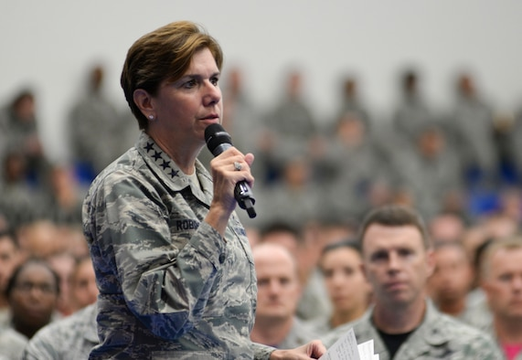 U.S. Air Force Gen. Lori Robinson, Pacific Air Forces commander, addresses Airmen during an all-call, July 10, 2015, Andersen Air Force Base, Guam. Robinson outlined her priorities including taking care of Airmen and their families while accomplishing the mission. (U.S. Air Force photo by Senior Airman Katrina M. Brisbin/Released)