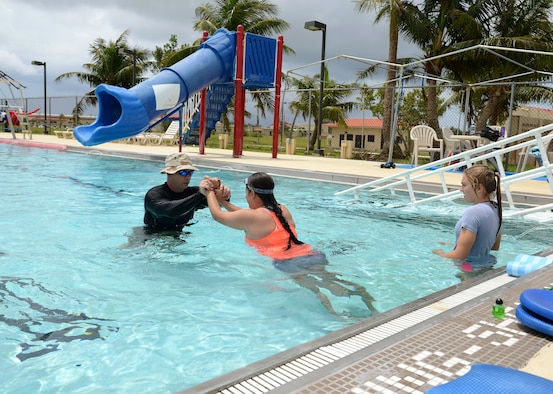 Maj. Michael Curtin, 36th Medical Operations Squadron Health Promotion Flight commander, instructs a group aquatic class July 7, 2015, at Andersen Air Force Base, Guam.  The class is designed for post-operation patients who need a lower impact exercise. (U.S. Air Force photo by Airman 1st Class Arielle Vasquez/Released)